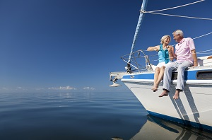older man and woman sitting on boat