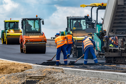 men working on pavement