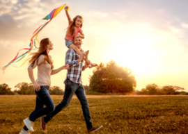 young family playing with kite